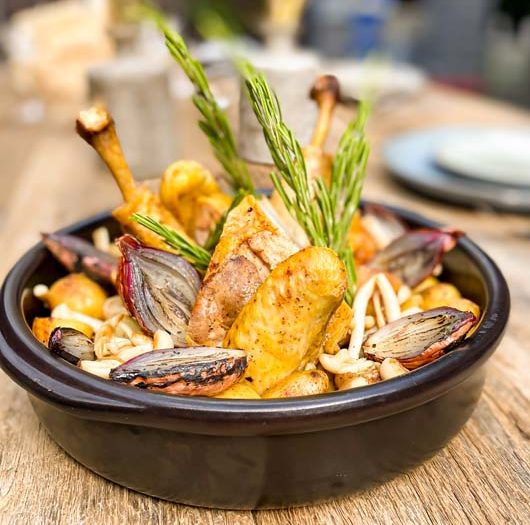 Roasted free-range chicken, shot, seasonal vegetables, rosemary juice